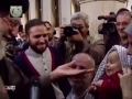 Clip - Imam Khamenei presented his Basiji Romaal to a Revolutionary Baby