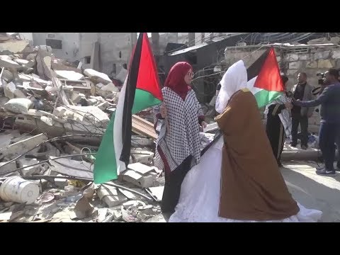 [7 April 2019] Gazan bride stands in front of the rubble of her family house  - English